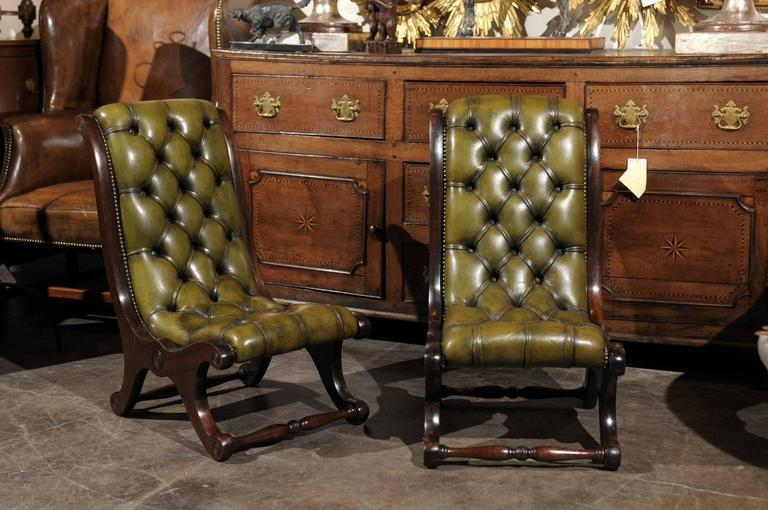A Pair Of Exquisite Turn Of The Century English Green Tufted Leather  Slipper Chairs. This