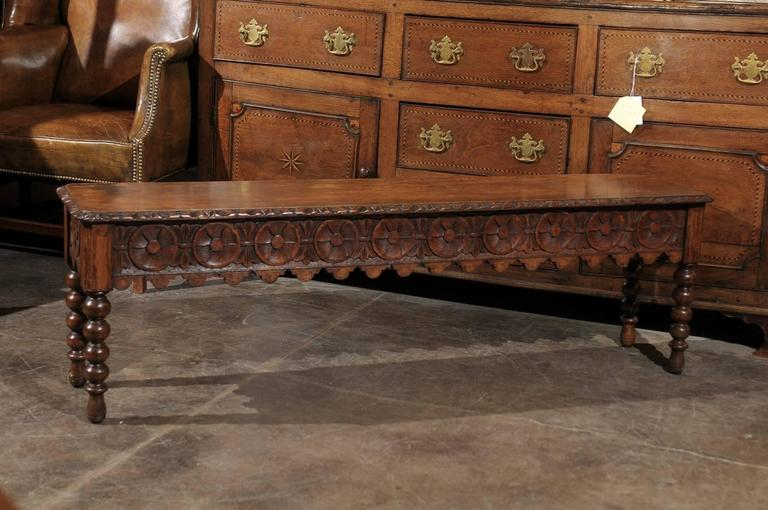 English late th century oak bench with bobbin legs and
