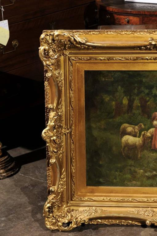 Large Antique Oil Painting of Sheep and Shepherdess in Antique Giltwood Frame In Good Condition For Sale In Atlanta, GA
