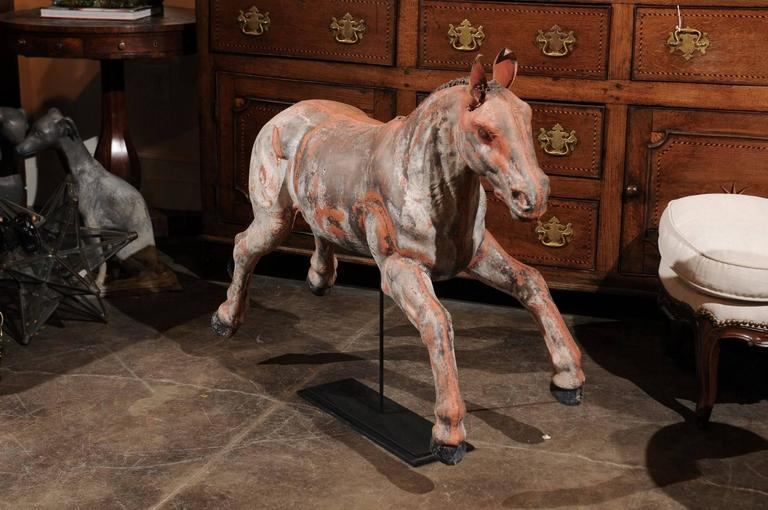 An exquisite continental foal baby horse from the early 20th century mounted on iron base. This joyful foal is caught in mid leap as it's possibly just learning how to gallop. See how its legs are shorter and more stout than a full grown horse and