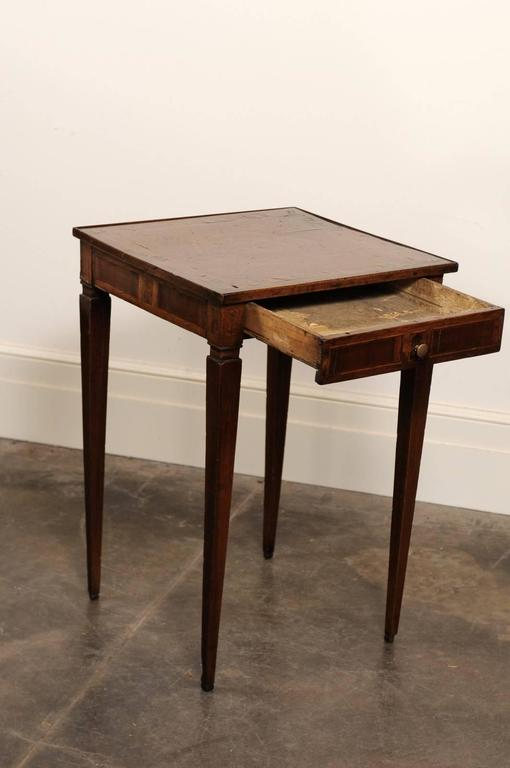 Italian accent table with marquetry top and tapered legs