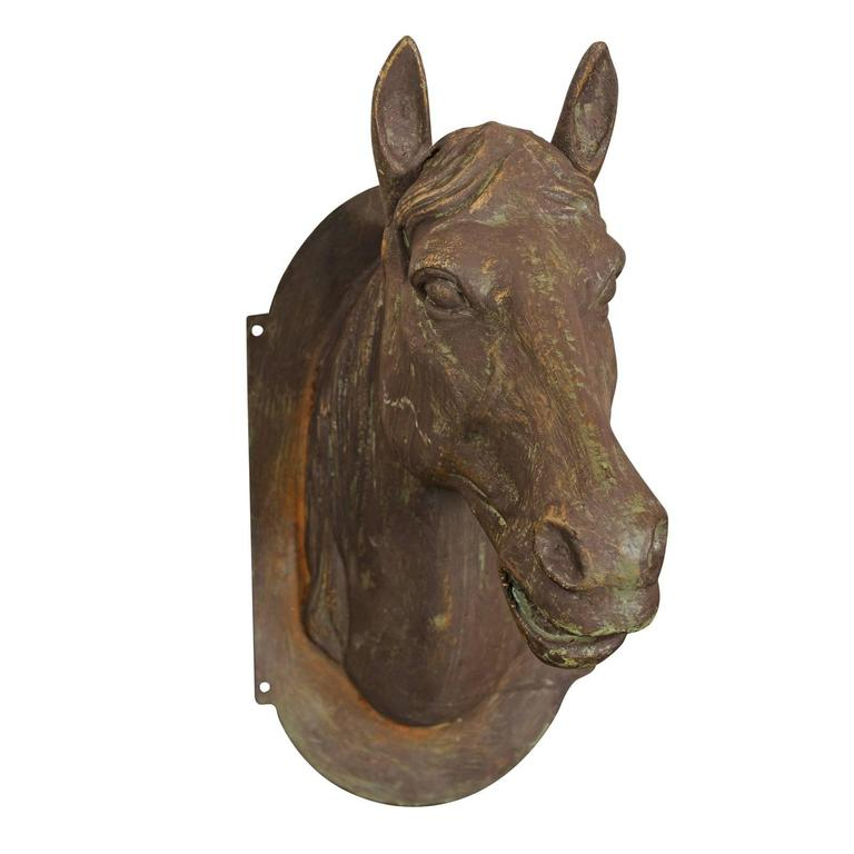 Cast iron horse head wall decoration from the mid 20th century for sale