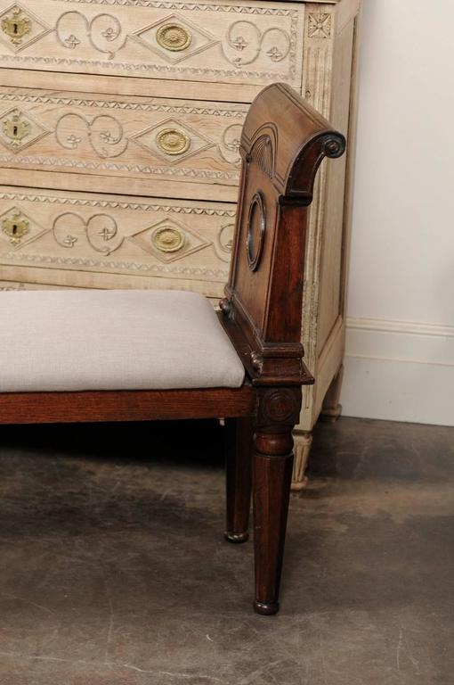English, 1880s Oak Backless Bench with Out-Scrolled Arms and Upholstered Seat For Sale 2