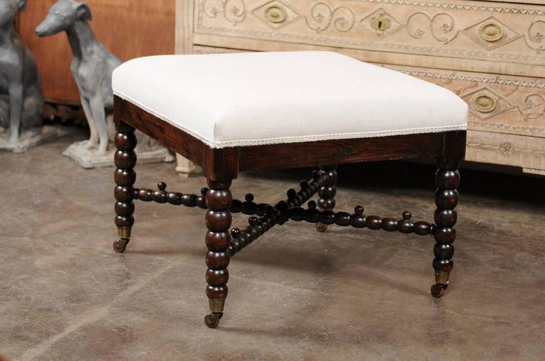 English Bobbin Leg Upholstered Ottoman With Unusual Cross
