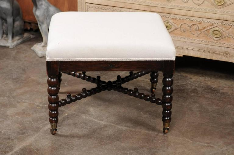 English Bobbin Leg Upholstered Ottoman With Unusual Cross