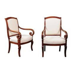 Pair of French Mid-19th Century Empire Style Walnut Fauteuils with Volute Arms