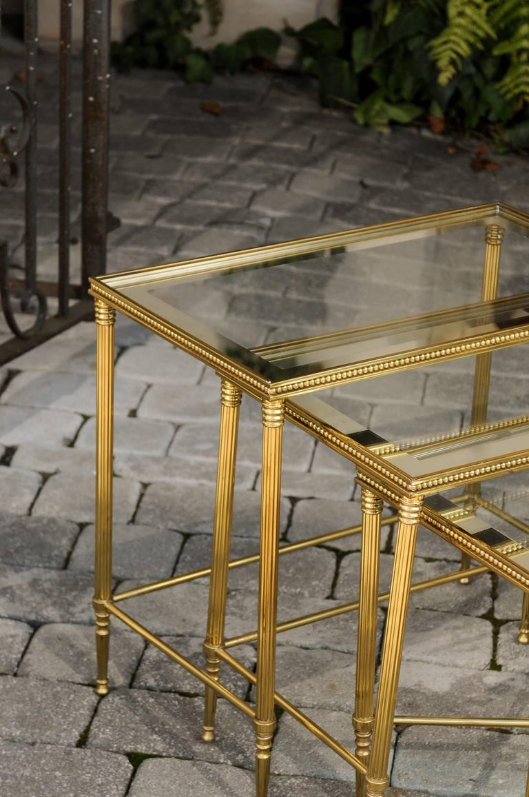 20th Century Set of Three 1950s French Brass and Glass Nesting Tables with Beaded Trim For Sale