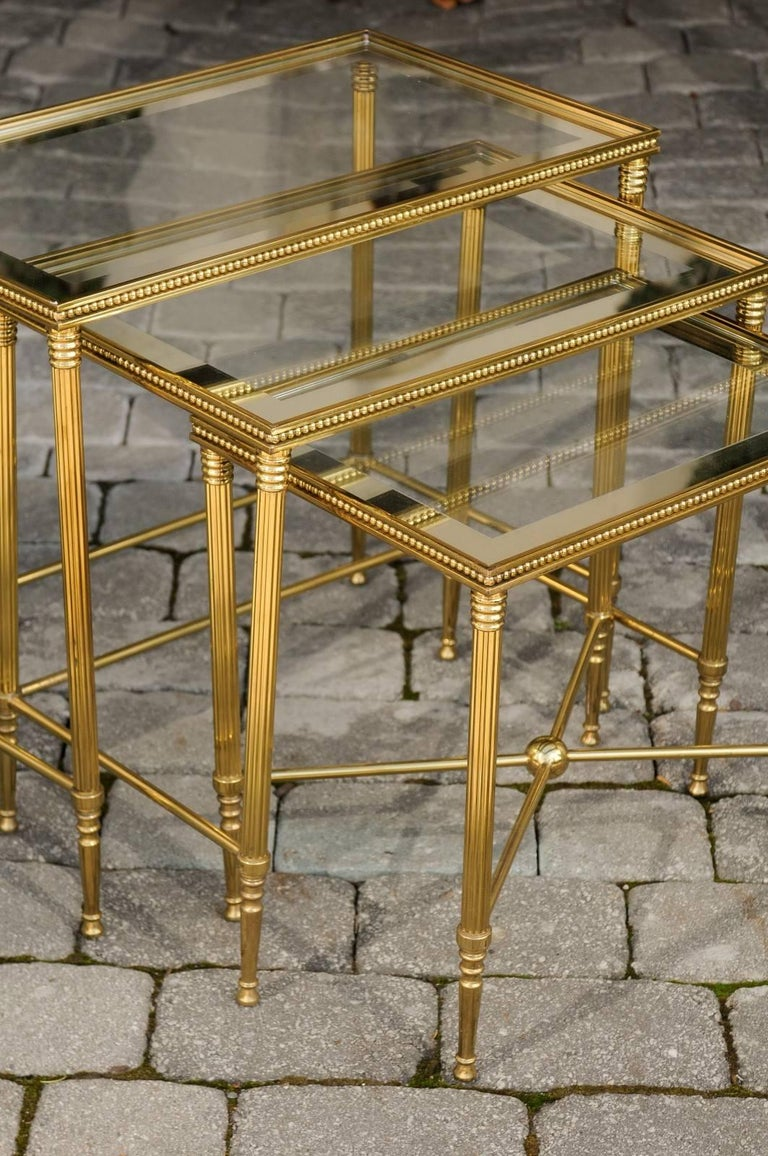 Set of Three 1950s French Brass and Glass Nesting Tables with Beaded Trim In Good Condition For Sale In Atlanta, GA