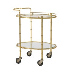 French Midcentury Brass Two-Tiered Oval Cart with Glass Shelves and Casters