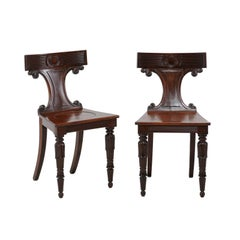 Pair of English Mahogany Hall with C-Scroll Motifs Chairs from the 1870s