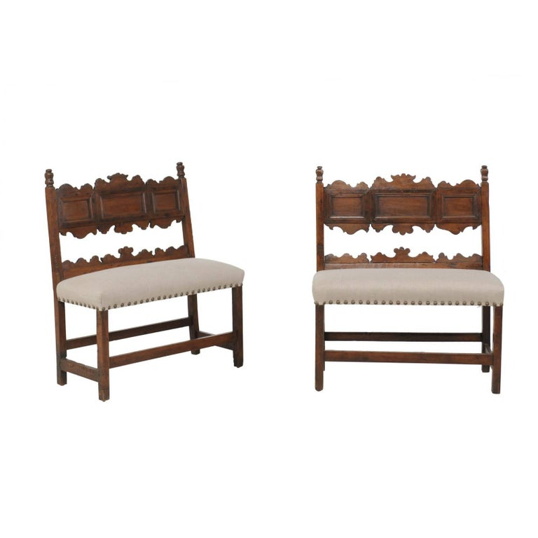 Pair of Italian 1820s Carved Walnut, Slanted Back Benches with New Upholstery For Sale