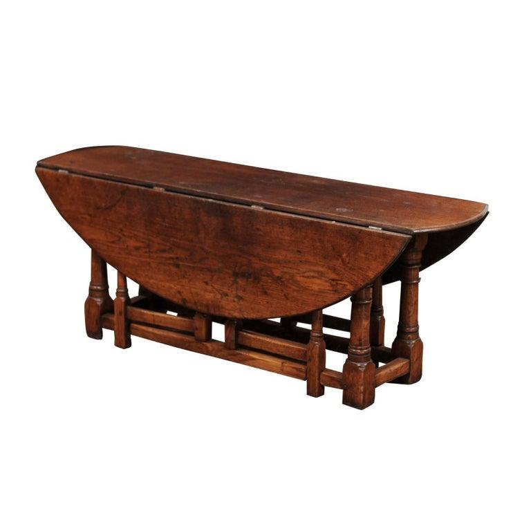English Oak Drop-Leaf Oval Top Coffee Table with Double Gateleg, circa 1880