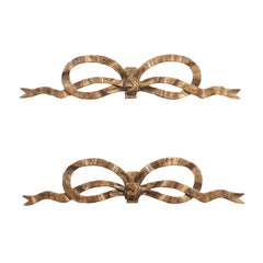 Pair of French Louis XVI Style Carved Giltwood Ribbon Decorations, circa 1900