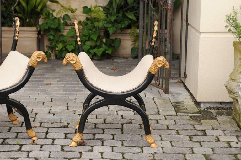 Wood Pair of English Regency Style Ebonized and Parcel-Gilt Curule Stools, circa 1880 For Sale