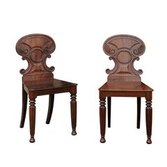 Pair of Regency Style 1870s Carved Mahogany Hall Chairs with C-Scroll Backs