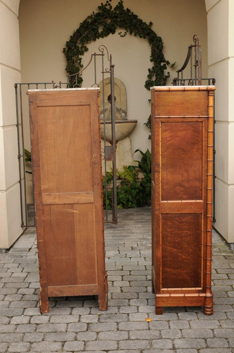A pair of French faux bamboo and burl wood semainiers from the second quarter of the 19th century, with conforming marble tops and geometric design. Born at the end of the reign of France's last Emperor Napoleon III, each of this pair of tall and