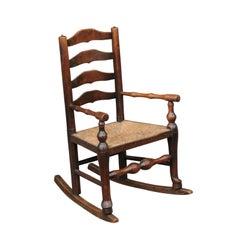 English 1800s Georgian Period Plum Wood Child's Rocking Chair with Rush Seat