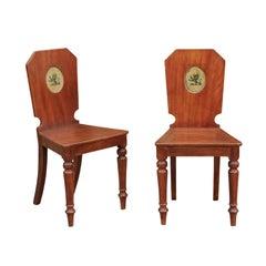 Pair of English Mahogany Hall Chairs with Heraldic Lion Motifs, circa 1870