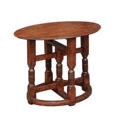 English Oval Oak Side Table with Turned Base and Cross Stretcher, circa 1860