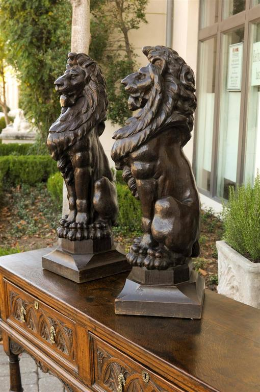 Pair of English Late 19th Century Large Wooden Carved Lions on Bases In Good Condition For Sale In Atlanta, GA