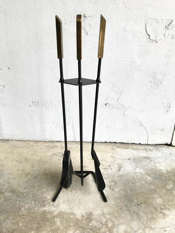 Modernist fireplace tools, circa 1950s with solid brass which have been left unpolished, but can be polished upon request. The frame has been resprayed and the brush is in excellent condition.