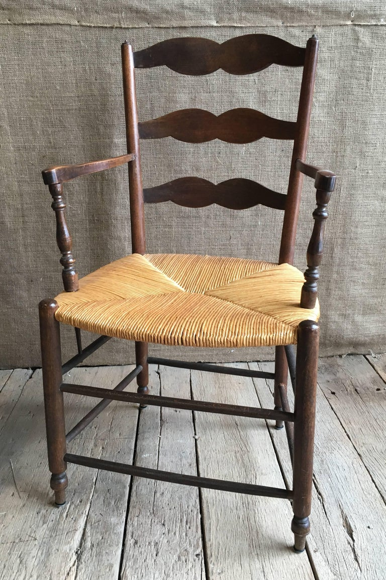 Carved Pair of French Provincial Armchairs with Rush Seats For Sale