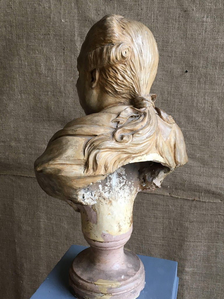 A late 18th-early 19th century terracotta bust of a corpulent nobleman, possibly German, attributed to Jean-Antoine Houdon, (1741-1828), circa 1800, retaining its original glaze and pedestal base. Nice patina and condition.