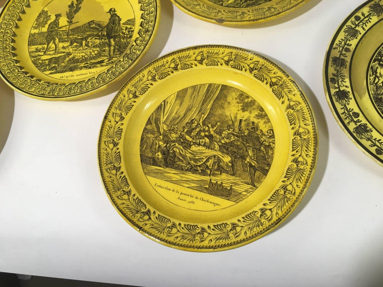 A collection of eight assorted ceramic plates in yellow glaze with various military, hunting, etc. scenes on each, from Creil et Montereau, circa 1810, France.