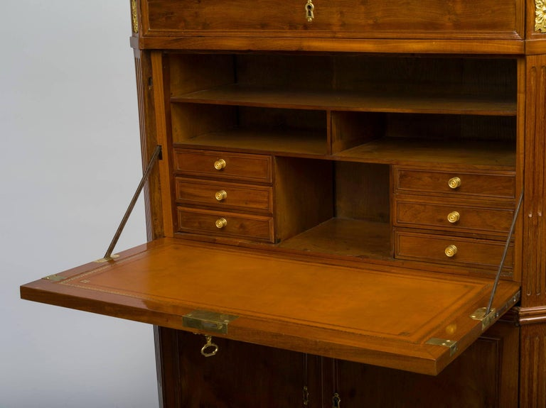 The later breccia marble top over two paneled doors opening to reveal shelves, above a drawer over a fall front with an interior fitted with drawers and compartments, and two further doors where the coffre-fort compartment used to be, raised on
