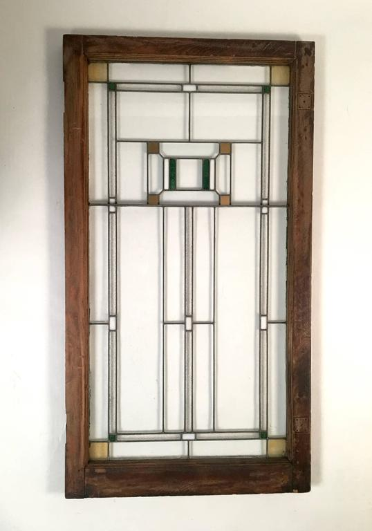 Two American Arts & Crafts period Prairie School windows, in the manner of Frank Lloyd Wright, possibly by George Grant Elmslie, who was an assistant of Louis Sullivan. Excellent condition. Clear glass, both flat and textured, with rectangles