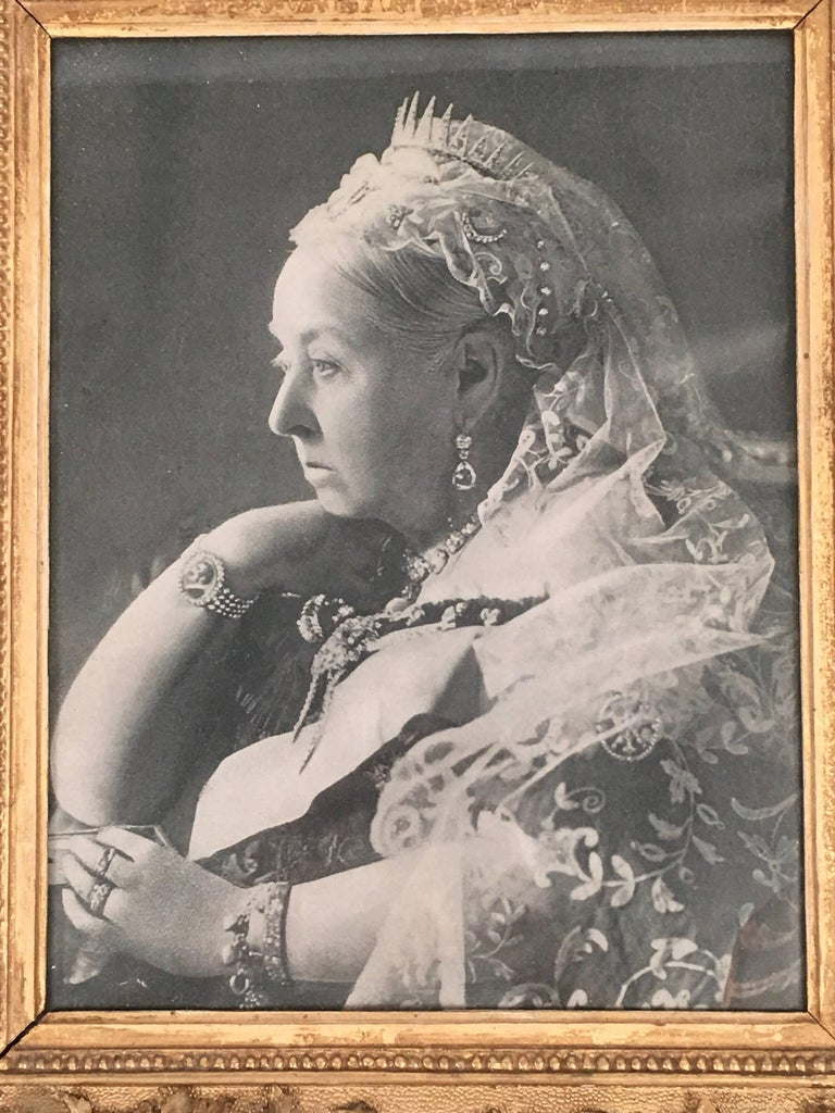 An Diamond Jubilee photogravure portrait of Queen Victoria (1819-1901), made on the occasion of her 60th anniversary on the throne in 1897. She is depicted with her chin resting on her hand, a pose which highlights her bracelet which features a