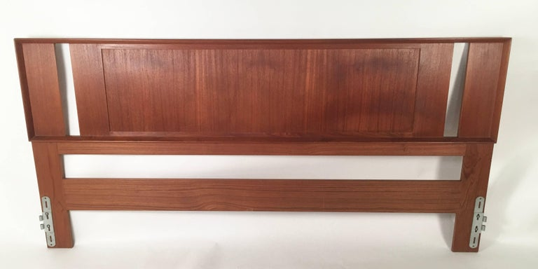 A Danish teak and grass cloth double sided king-sized headboard made by Falster, circa 1960-1970, in perfect condition. Richly figured wood with molded edge on one side and pristine grass cloth panel on the other. This headboard does not require