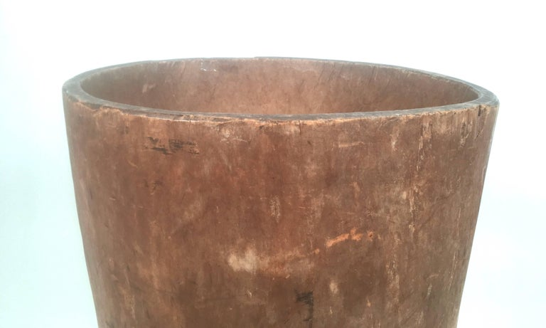 An American early 19th century large storage barrel, carved from a whole tree trunk, of tapering cylindrical form with an applied one bottom. The shape is irregular, as nature made it. Perfect for use as a planter or for walking sticks and