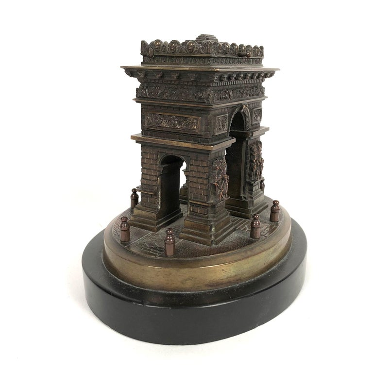 A small Grand Tour bronze architectural model of the Arc de Triomphe in Paris, mounted on anvil black marble base. Created as a souvenir in the late 19th century for travelers to Paris, this model is very well detailed, showing the sculptural