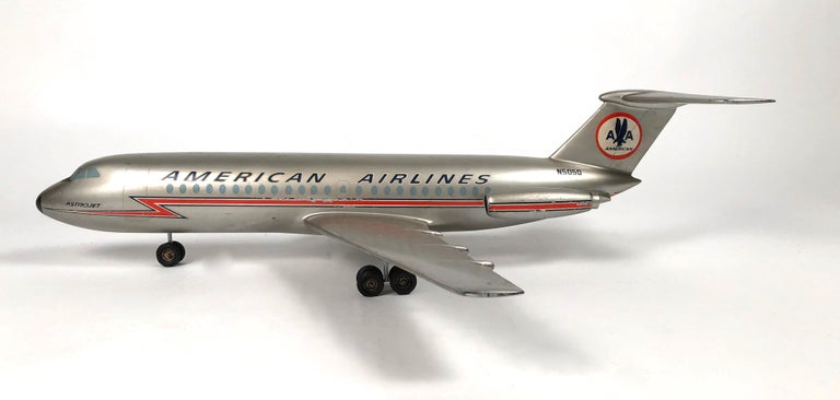 A vintage American Airlines Astrojet aviation model, circa 1950-1960s, in silver painted metal with aircraft livery in red, white and blue, the fuselage and wings with applied decals and extended landing gear.   Provenance: The Collection of