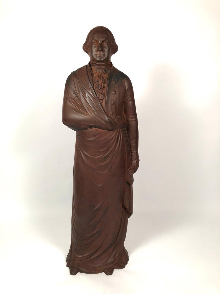 A striking 19th century cast iron figure of George Washington, the full-body figure composed of two joined halves with a well detailed head, body and robe details, the back inscribed in cursive, in the casting,
