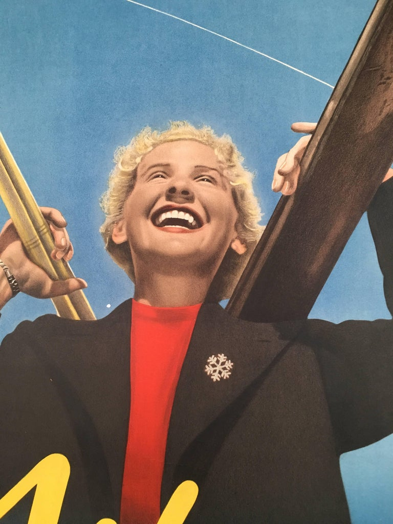 A striking pre-war collage ski poster featuring both photographic and graphic images advertising the alpine resort of Wengen, Switzerland, featuring an ebullient blond smiling woman carrying her skis and poles, wearing a red sweater with black