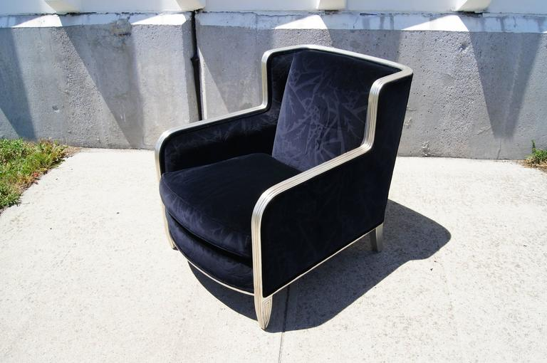 This luxurious club chair comes from Chicago-based custom furniture maker Interior Crafts. It is a beautiful late-20th- century interpretation of the art deco style, with deep blue cut velvet upholstery and a carved hardwood frame gilded with silver