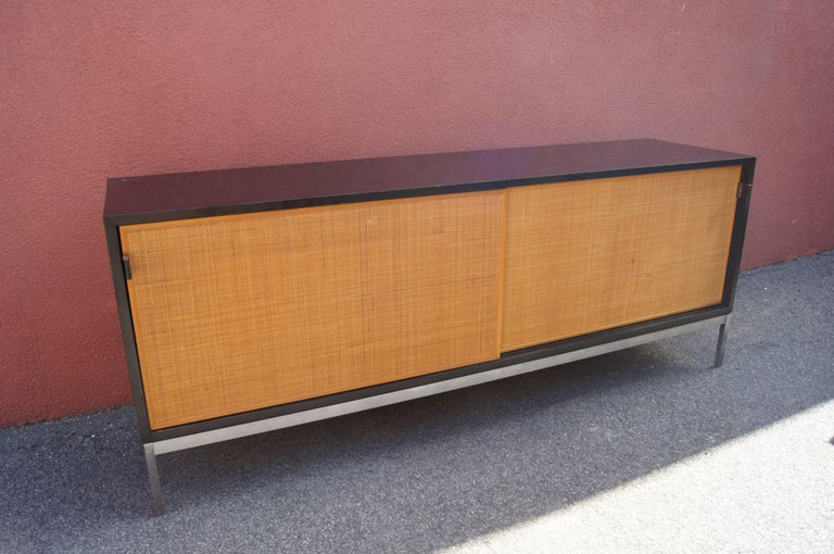 Mid-20th Century Credenza with Cane Doors and Black Laminate Case by Florence Knoll For Sale
