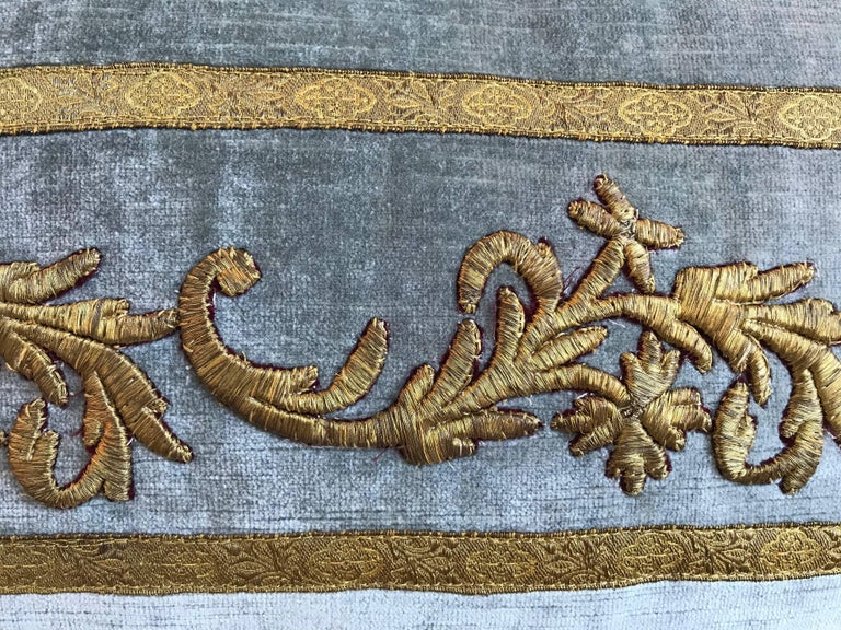 Antique Ottoman Empire raised gold metallic embroidery bordered with antique gold metallic galon on pale French blue velvet. Hand-trimmed with vintage military cording knotted in the corners. 90/10 down feathers.