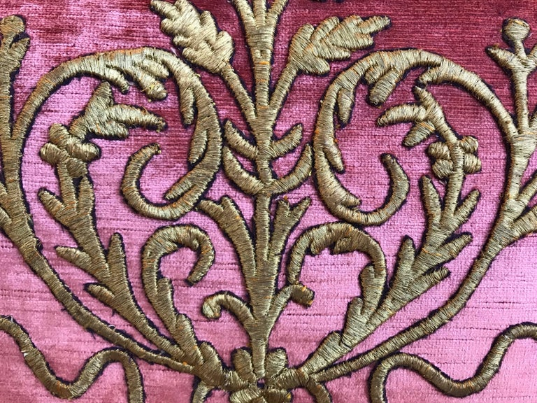 Antique ottoman Empire raised gold metallic embroidery on faded red velvet. Hand-trimmed with tiny vintage cording knotted in the corners. Down-filled.
