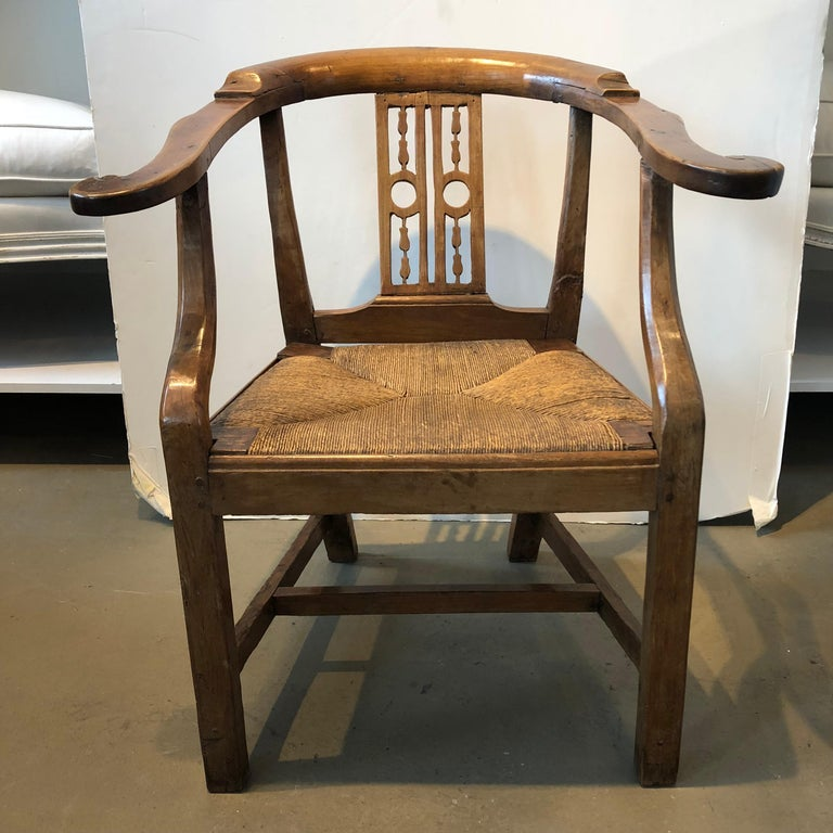 18thcentury Italian fruitwood corner armchair with rush seat.
