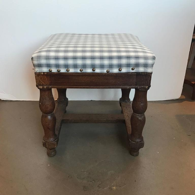 19th century upholstered stool with nailheads.