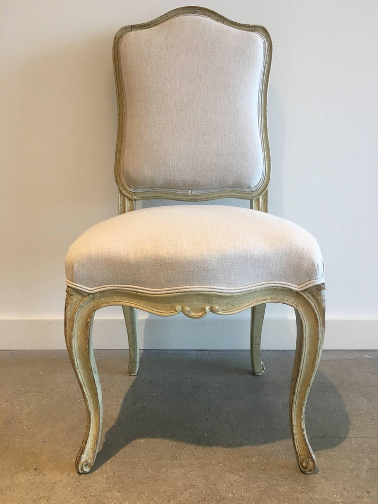 Set of six 19th century Louis XV dining chairs. Eggshell paint. Newly stabilized and reupholstered.