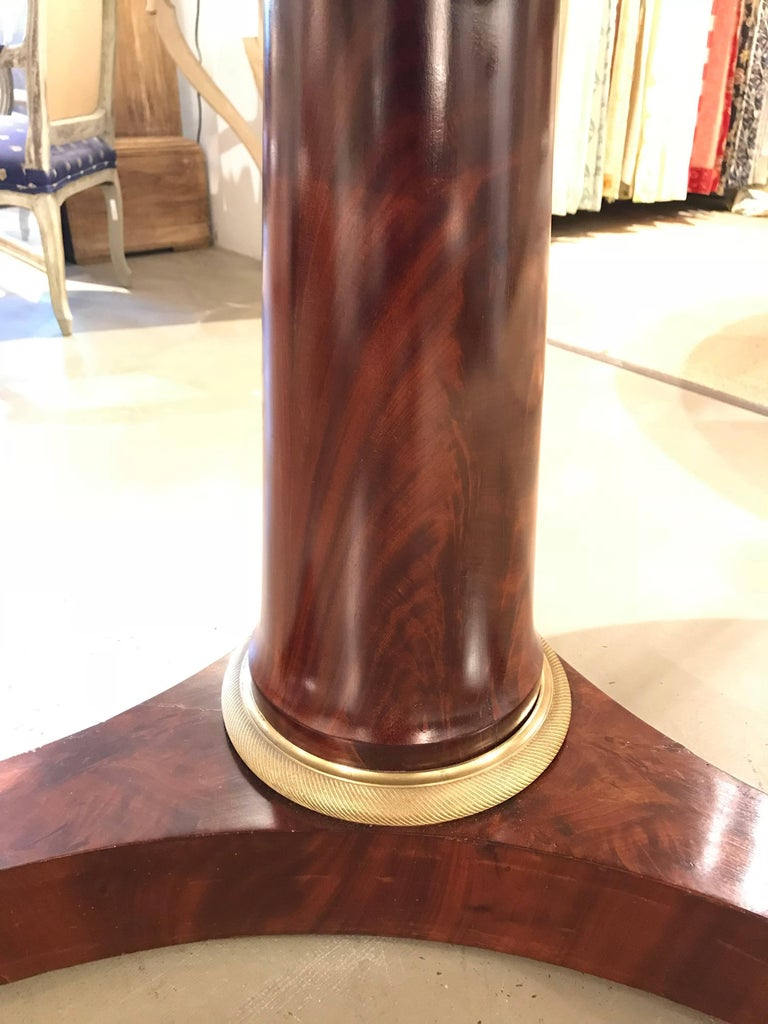 Pedestal table with Belgian black marble-top and mahogany or walnut veneer. French Empire, first quarter 19th century.