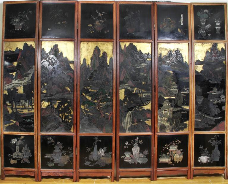 Double-sided with one side with scenes depicting court life, the back animal and floral scenes, each panel in a teakwood frame.