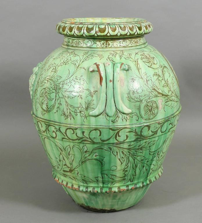 Blueish green glaze, baluster form with cartouche on one side and gargoyle face on reverse. Signed Maria on side.