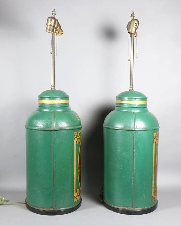 Green painted tea canisters from Parnall & Sons, Bristol, featuring scenes of Asian men and women performing daily routines.