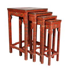 Nest of Four Chinese Red Lacquered Tables