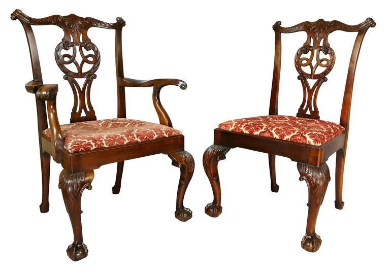 Each very sturdy and wonderful generous scale with serpentine carved crestrail over a pierced splat with carving and drop in upholstered seat raised on cabriole legs with ball and claw feet.